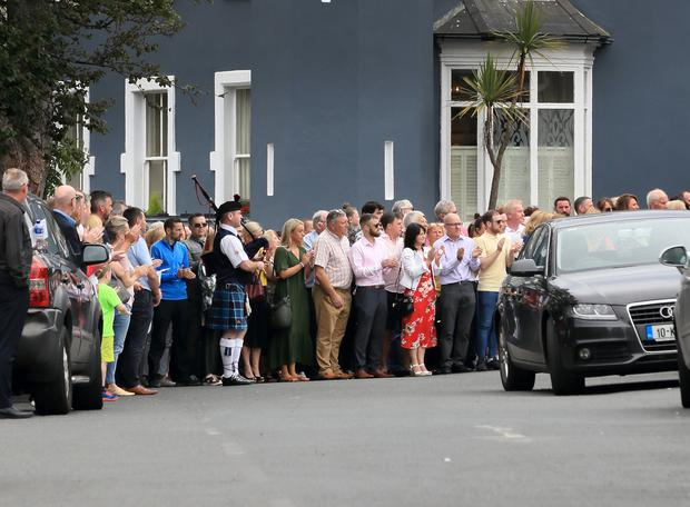 Mourners appalud as the remains of John Pender are carried from Killiney Castle Hotel at the celebration of the life of John Pender ceremony in Killiney Castle. Picture: Frank McGrath