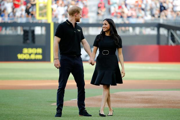 Britain's Prince Harry, Duke of Sussex and Britain's Meghan, Duchess of Sussex arrive on the field prior to the start of the first of a two-game series between the New York Yankees and the Boston Red Sox at London Stadium in Queen Elizabeth Olympic Park, east London on June 29, 2019