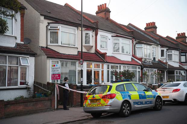 Police at the scene in Raymead Avenue, Thornton Heath, Croydon where a women who was around eight months pregnant has been stabbed to death and her baby is critically ill in hospital. Kirsty O'Connor/PA Wire