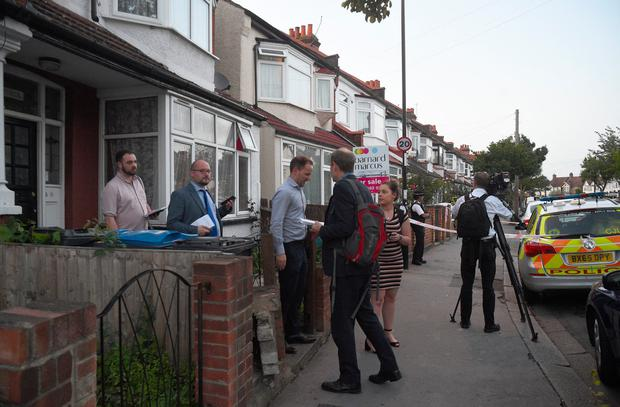 Police officers carrying door to door inquiries in Raymead Avenue, Thornton Heath, Croydon where a women who was around eight months pregnant has been stabbed to death and her baby is critically ill in hospital. Kirsty O'Connor/PA Wire