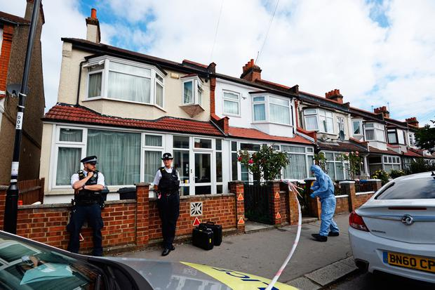 Police officers at the scene in Raymead Avenue, Thornton Heath, Croydon where a women who was around eight months pregnant was stabbed to death. Kirsty O'Connor/PA Wire