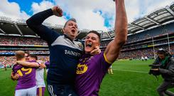 Lee Chin of Wexford celebrates with Wexford manager Davy Fitzgerald after winning the Leinster GAA Hurling Senior Championship Final match between Kilkenny and Wexford at Croke Park in Dublin. Photo by Ramsey Cardy/Sportsfile