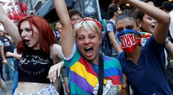 LGBT rights activists shout slogans as they try to march for a pride parade, which was banned by the governorship, in central Istanbul, Turkey, June 30, 2019. REUTERS/Murad Sezer