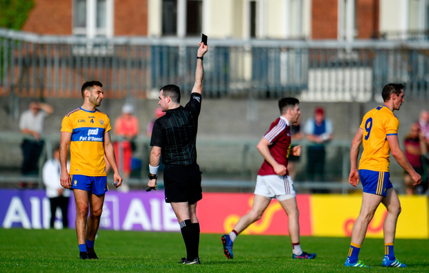Cathal O'Connor of Clare leaves the field after being shown a black card by referee Martin McNally. Photo by Sam Barnes/Sportsfile
