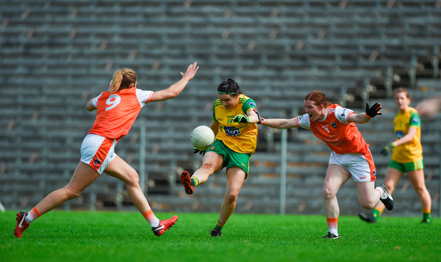 Geraldine McLoughlin of Donegal kicks to score a point despite the attention of Caroline O'Hanlon, left, and Caoimhe Morgan of Armagh. Photo by Ben McShane/Sportsfile