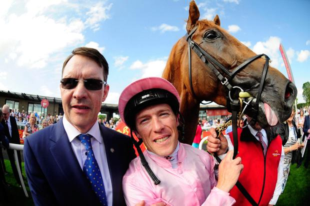 Trainer Aidan O'Brien and Padraig Beggy with Sovereign after winning Saturday's Dubai Duty Free Irish Derby. Photo: PA/WIRE