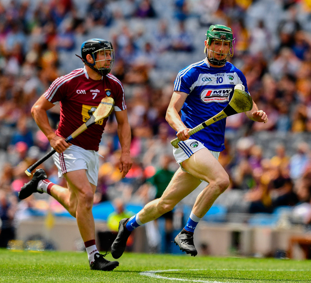 Aaron Dunphy of Laois powers away from Westmeath's Paul Greville to score his side's second goal. Photo by Ray McManus/Sportsfile