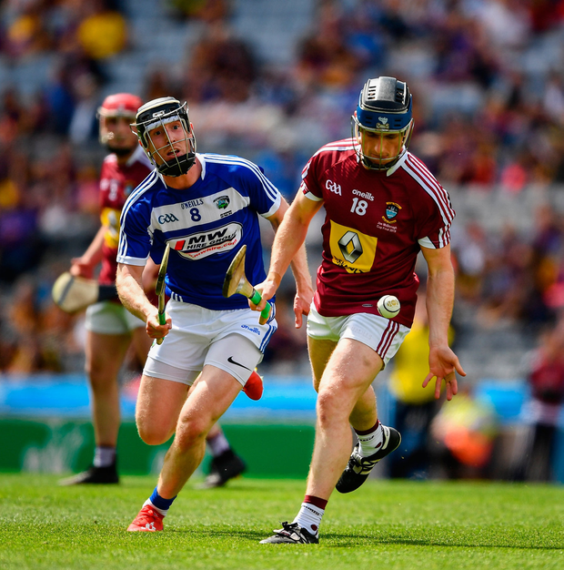 Eoin Price of Westmeath in action against John Lennon of Laois. Photo by Ray McManus/Sportsfile