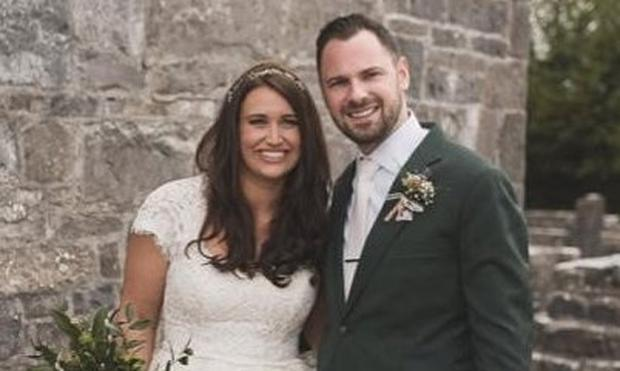 Devoted: The late Caitlin Holtzman and JohnJohn Heneghan married in Ballintubber Abbey in 2015
