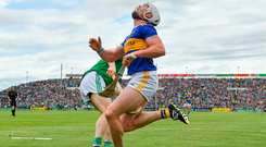 Tipperary's Padraic Maher is knocked on to the ground by this collision with Limerick's Graeme Mulcahy at the LIT Gaelic Grounds. Photo by Brendan Moran/Sportsfile