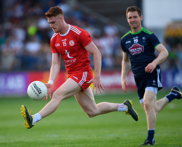 Tyrone on the charge: Conor Meyler of Tyrone gets away from Kildare's Eoghan O'Flaherty during Saturday's qualifier in Newbridge. Photo: Ramsey Cardy/Sportsfile