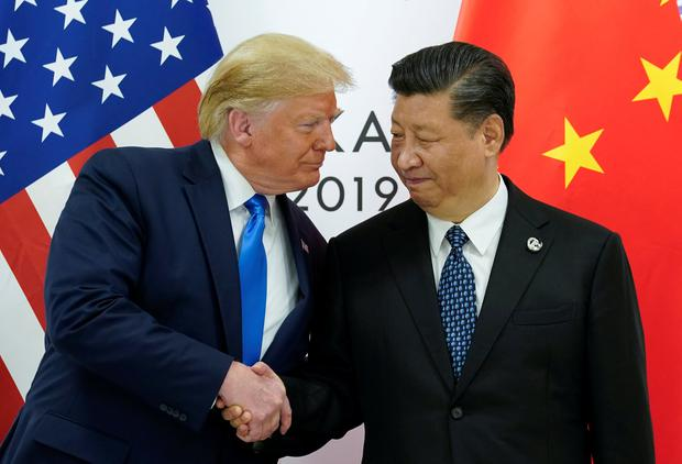 Easing of tensions: US President Donald Trump meets with China's President Xi Jinping at their bilateral meeting at the G20 leaders summit in Japan. Photo: REUTERS/Kevin Lamarque