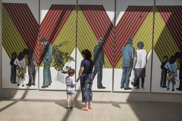 Art on their sleeve: Emma Russell with her daughter Caitlin looking at the installation 'People & a Frank Stella' by artist Robert Ballagh in the Showgrounds Shopping Centre, Clonmel, Co Tipperary, part of The Clonmel Junction Arts Festival, which runs until Sunday. Photo: John D Kelly