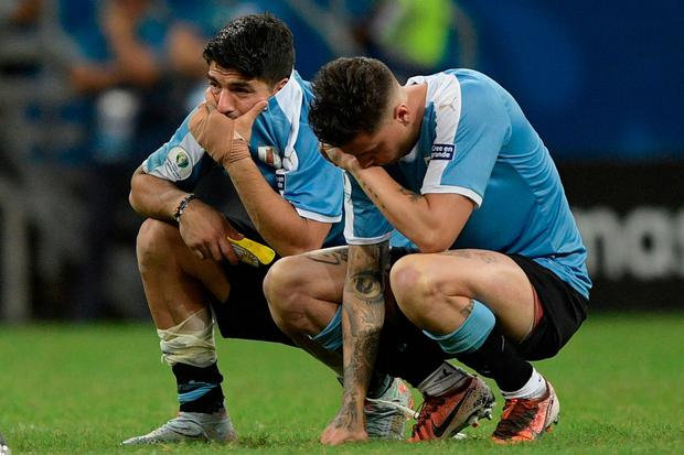 A dejected Luis Suarez and team-mate Jose Maria Gimenez following their penalty shoot-out defeat to Peru which saw Uruguay exit the Copa America. Photo: JUAN MABROMATA/AFP/Getty Images