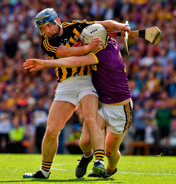 Ger Aylward of Kilkenny is tackled by Liam Ryan of Wexford. Photo by Ray McManus/Sportsfile