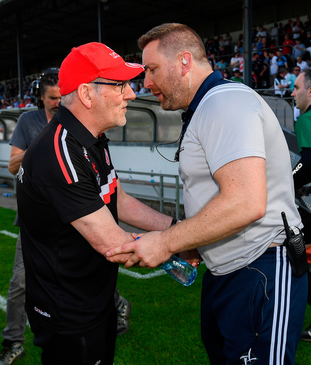 Tyrone manager Mickey Harte shakes hands with Cian O'Neill after the Kildare boss' defeat to the Red Hand. Photo: Ramsey Cardy/Sportsfile