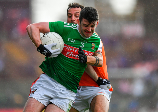 BATTLE: Mayo's Brendan Harrison under pressure from Armagh's Jamie Clarke. Photo by Brendan Moran/Sportsfile