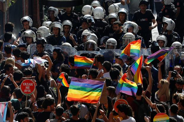 Riot police prevent LGBT rights activists from marching. Photo: Reuters/Murad Sezer