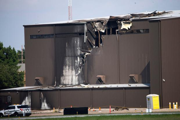 Damage is seen to a hangar after a twin-engine plane crashed into the building at Addison Airport in Addison, Texas. Picture: Shaban Athuman/The Dallas Morning News via AP