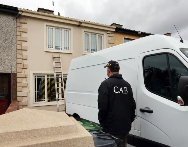 Members of CAB pictured outside the property which they repossessed Picture Credit: Frank McGrath