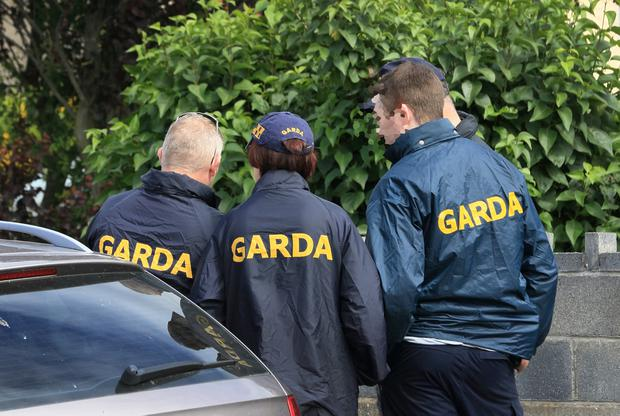 Gardaípictured outside the property which CAB repossessed Picture Credit: Frank McGrath