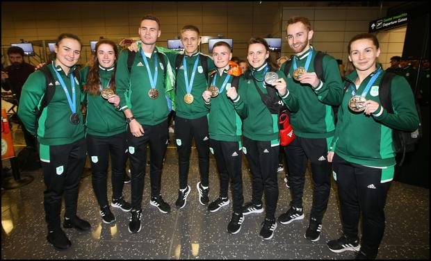 Athletes Kellie Harrington, Grainne Walsh, Michael Nevin, Kurt Walker, Regan Buckley, Michaela Walsh, Sam Magee and Chloe Magee celebrate their Team Ireland homecoming from the European Games in Minsk at Dublin Airport. Pic Steve Humphreys