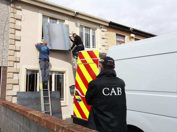 Boarded up: The house in Rowlagh Park, Clondalkin, which has been seized by the CAB. PHOTO: FRANK McGRATH