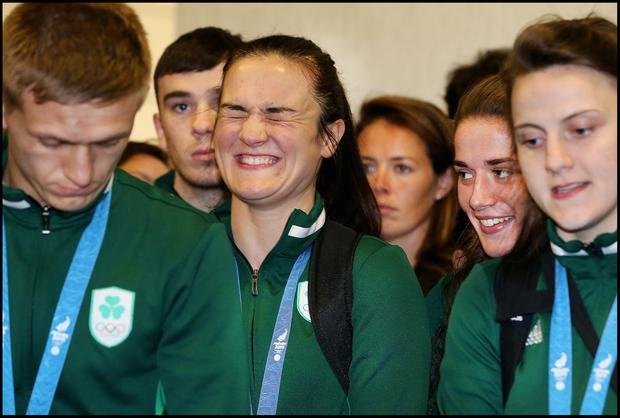 Delight: Boxer Kellie Harrington can't contain her excitement at the Team Ireland homecoming at Dublin Airport. Photo: Steve Humphreys