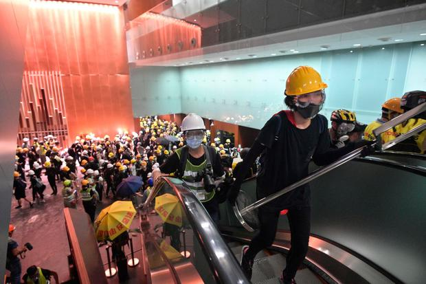 Challenge to power: Protesters smash their way into the Hong Kong government buildings yesterday. Photo: ANTHONY WALLACE/AFP/Getty Images