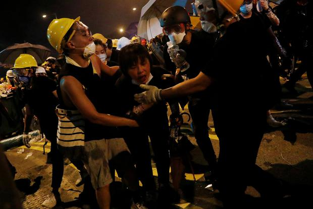 Dissent: Protesters react to a tear gas fired by police outside the Legislative Council building. Photo: REUTERS/Tyrone Siu
