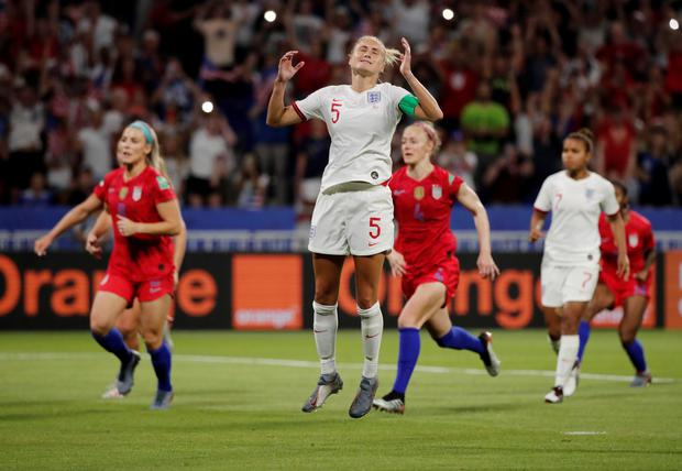 England's Steph Houghton reacts after missing a penalty as Alex Morgan of the U.S. and team mates celebrate in the Women's World Cup semi-final at the Groupama Stadium, Lyon, France. Photo: REUTERS/Benoit Tessier