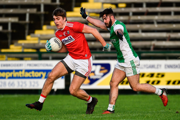 Beaten to the chase: Cork's Ian Maguire in action against Kane Connor of Fermanagh during last January's league clash. Though the Rebels (15th) ranked behind Fermanagh (11th)in the NFL, they beat their Ulster counterparts to a place in the 'Super 8s'. Photo: Oliver McVeigh/Sportsfile