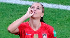 USA's Alex Morgan (left) celebrates scoring her side's second goal of the game during the FIFA Women's World Cup Semi Final match at the Stade de Lyon. Richard Sellers/PA Wire