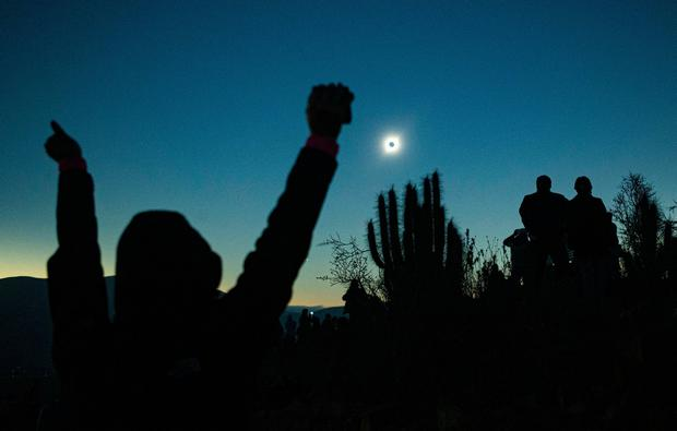People view a total solar eclipse from La Higuera, Chile, Tuesday, July 2, 2019. Tens of thousands of tourists and locals gaped skyward Tuesday as a rare total eclipse of the sun began to darken the heavens over northern Chile. (AP Photo/Esteban Felix)