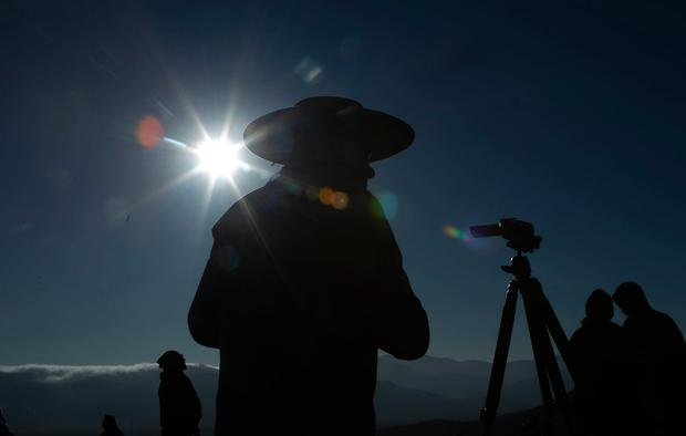 People watch a total solar eclipse in La Higuera, Chile, Tuesday, July 2, 2019. Northern Chile is known for clear skies and some of the largest, most powerful telescopes on Earth are being built in the area, turning the South American country into a global astronomy hub. (AP Photo/Esteban Felix)