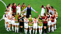 England head coach Phil Neville (centre) talks to the players after the final whistle. Richard Sellers/PA Wire.