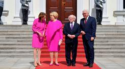 German President Frank-Walter Steinmeier (R) and his wife Elke Buedenbender (L) pose with President Michael D Higgins (2nd R) and his wife Sabina Higgins in front of the presidential Bellevue Palace in Berlin. Photo by Tobias SCHWARZ / AFP)TOBIAS SCHWARZ/AFP/Getty Images