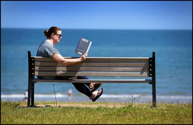 Enjoying the weather at Portmarnock Beach with a good book was Claire Daly from Swords. Picture: Steve Humphreys