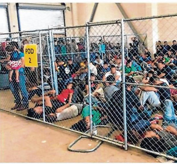 Cramped conditions: Migrant families were held in overcrowded pens at a Border Patrol facility in McAllen in southern Texas. Photo: AFP/Getty Images