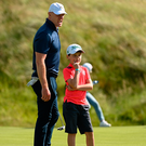 Former Ireland rugby captain Paul O'Connell lines up a putt with his son, and caddie for the day, Paddy during the Pro-Am ahead of the Dubai Duty Free Irish Open, which starts today at Lahinch Golf Club. Photo: Sportsfile