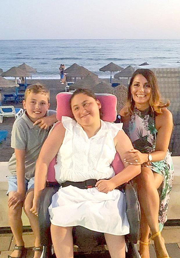 'Amazing woman': Ciara Ormond with her mum Jean and brother Cillian. Photo: Collins Courts