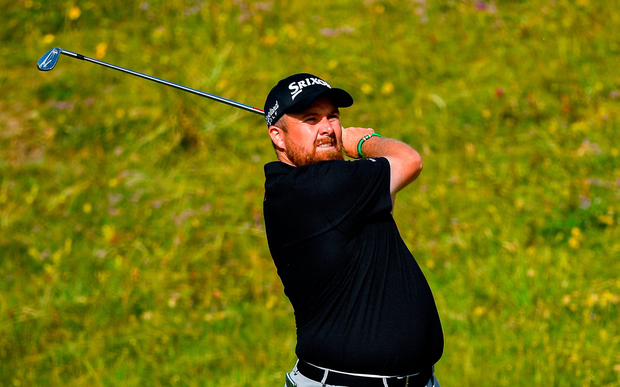Shane Lowry of Ireland plays his second shot on the fourth fairway during day one