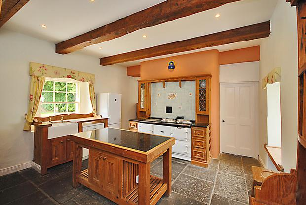 The kitchen comes with pitch pine units, a flagged stone floor and Aga