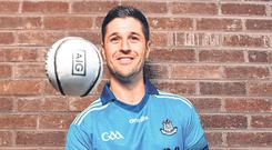 Eye on the ball: Hurler David Treacy with the jersey that all Dublin teams will wear for the upcoming ladies' football, camogie, football and hurling games. Photo: Sportsfile