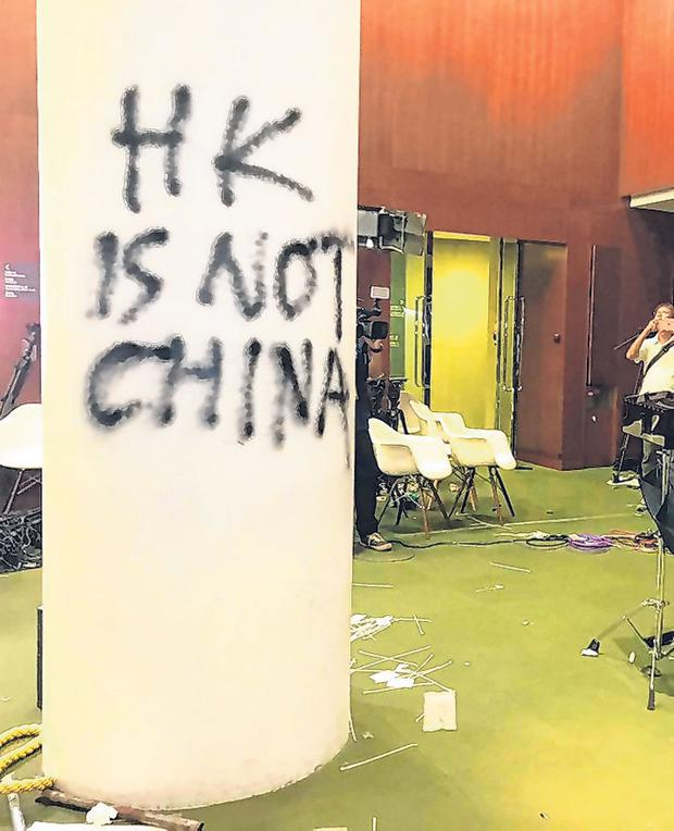 Destruction: The Legislative Council of Hong Kong was damaged following a break-in by protesters. Photo: Johnson Lai/AP