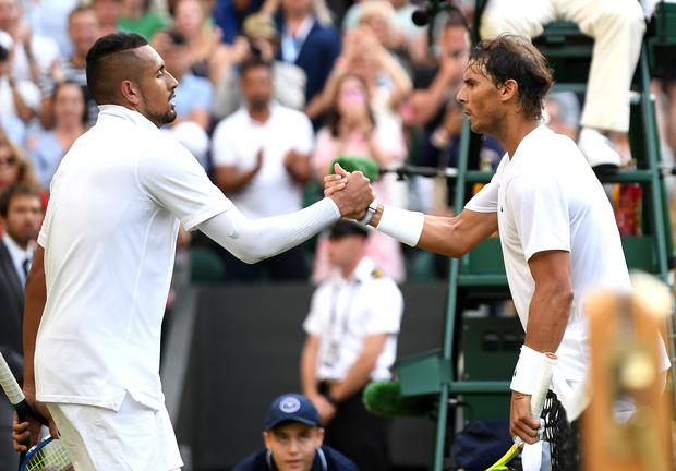 LONDON, ENGLAND - JULY 04: Rafael Nadal of Spain shakes hands at the net with Nick Kyrgios of Australia after their Men's Singles second round match (Photo by Mike Hewitt/Getty Images)
