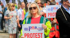 Making voices heard: Annie Duffy from Monaghan during a Psychiatric Nurses Association protest at Leinster House, Dublin over union recognition. Photo: Gareth Chaney/Collins