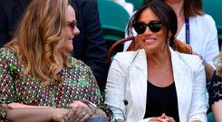 Britain's Meghan (R), Duchess of Sussex watches US player Serena Williams playing against Slovakia's Kaja Juvan during their women's singles second round match on the fourth day of the 2019 Wimbledon Championships at The All England Lawn Tennis Club in Wimbledon, southwest London, on July 4, 2019. (Photo by GLYN KIRK / AFP)
