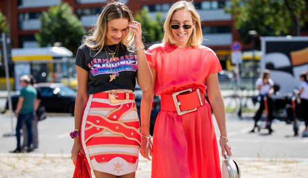 Nina Suess wearing skirt and tshirt with print and Sonia Lyson is seen wearing pink dress, white Prada bag, Louis Vuitton sneaker outside Marina Hoermanseder during Berlin Fashion Week on July 04, 2019 in Berlin, Germany. (Photo by Christian Vierig/Getty Images)