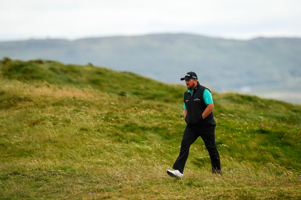 Shane Lowry of Ireland walks down to the 7th hole during day two of the 2019 Dubai Duty Free Irish Open at Lahinch Golf Club in Lahinch, Clare. Photo by Ramsey Cardy/Sportsfile